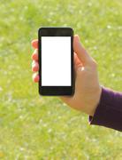 hand holding smart phone. - stock photo