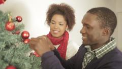 African couple decorating the christmas tree Stock Footage