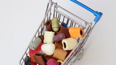 Shopping cart full of sweets Stock Footage