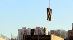 Construction site. Tower crane ship the formwork Stock Footage