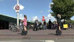 Two women using Segways in Amsterdam, Netherlands.. Stock Footage