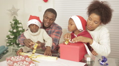 family preparing the christmas presents - stock footage