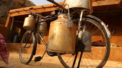Milk can on cycle Rural area at Rajasthan India - stock footage