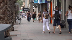 Busy sidewalk with beggar, Alicante Stock Footage