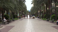 Palm tree lined walkway in downtown Alicante Stock Footage