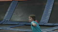 TRAMPOLINE DODGE BALL / KID TAKES A SHOT AND BOUNCES AWAY Stock Footage