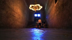 Dark hallway with polished pebbles on the floor passageway inside Hagia Sophia Stock Footage