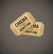 Two old cinema tickets for cinema over grunge background Stock Illustration
