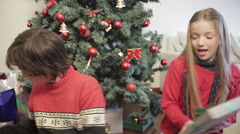 Kids looking the christmas presents - stock footage