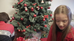 Children accommodating christmas gifts - stock footage