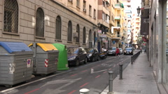 Narrow street with dumpsters and cars - stock footage