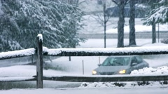 Car Drives On Snow Covered Road - stock footage