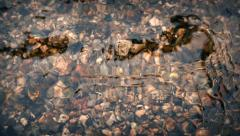 River Bed Through Glassy Water - stock footage