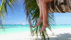 Woman legs on palm Stock Footage