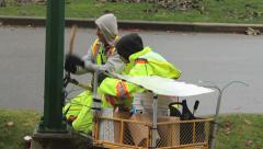 Two Powerline Technicians Cutting Wires On Street Lamp Stock Footage