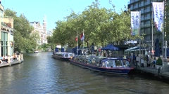 Blue Boat canal crusie boats moored in Amsterdam, Netherlands. Stock Footage