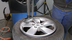 Man Breaking The Tire Off From The Rim by special tool, closeup view Stock Footage