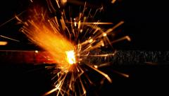 Sparkler burning on black background. Closeup. - stock footage