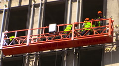 "Workers install a ventilated facade system. Construction site ""VTB. Arena Park"". Stock Footage"