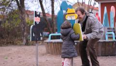 Father and daughter in playground having fun in fall winter time Stock Footage