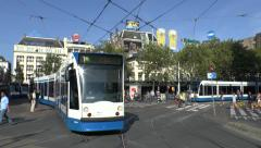Three trams criss-crossing tracks on Liedseplein, Amsterdam, Netherlands. Stock Footage