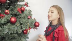 Girl assembling the christmas tree Stock Footage
