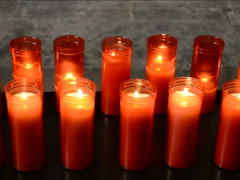 Fire in temple candles. Related clips are in my portfolio in 1920x1080. - stock footage