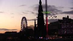 Edinburgh Scott Monument. Carousels and big wheel at Christmas. Stock Footage