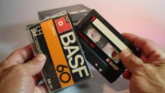 Man seeing old cassette tape Stock Footage