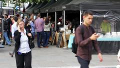 People using mobile phones near Manchester Piccadilly street food market Stock Footage