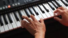girl playing the organ - stock footage