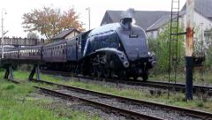 Sir Nigel Gresley leaving Ramsbottom station - stock footage