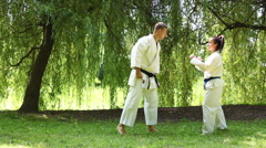 Two young Martial Arts fighters practicing in nature Stock Footage