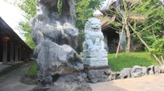 stone lions, mascot at the temple,  Asia - stock footage