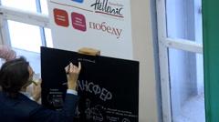Young man write on the blackboard Stock Footage