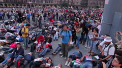 Crowd shouting slogans in a march protest for the students disappeared Guerrero Stock Footage