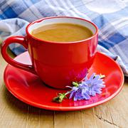 Chicory drink in red cup with napkin on board Stock Photos