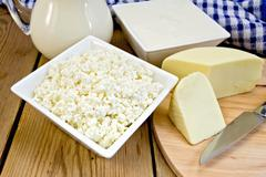 Curd with cheese and napkin on board Stock Photos