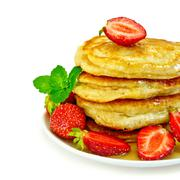 flapjacks with strawberries and mint - stock photo
