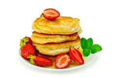 flapjacks with strawberries and mint in plate - stock photo