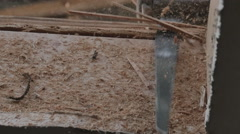 carpenter sawing with dust specks 2 - stock footage