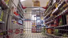 Shopping cart moving through supermarket aisles Stock Footage