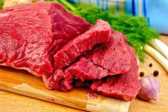 Meat beef with herbs on wooden board Stock Photos
