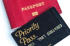 Priority Pass for VIP lounge access and international passport. Stock Photos