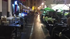 POV walking at nighttime. Sidewalk Caffe' and Bars in Catania city. Stock Footage