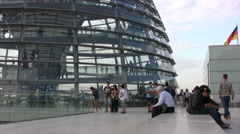Tourists walking around outside the glass dome of the Reichstag building Stock Footage