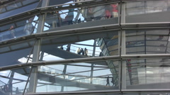 Tourists walking around inside the Reichstag dome viewed from outside Stock Footage