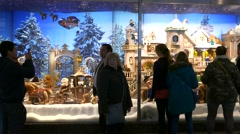 4K FHD People looking at Christmas Fair Market Shopping Window display Stock Footage
