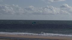 Solitary kitesurfer riding the waves at North Sea beach ridge at Maasvlakte Stock Footage