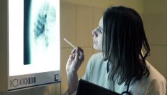 Female doctor checking lungs xray on tablet computer in hospital  HD Stock Footage